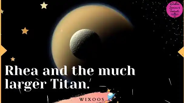 Rhea and the much larger Titan