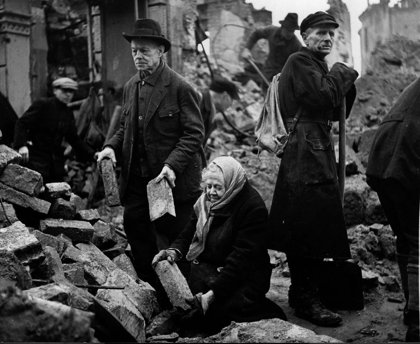 Gustav and Alma Piltz help to clear rubble. 1946.