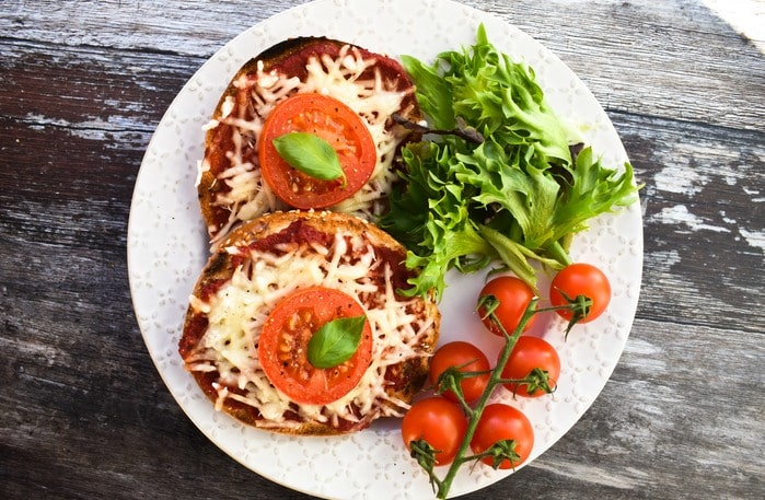 2 quick bagel pizzas topped with tomato