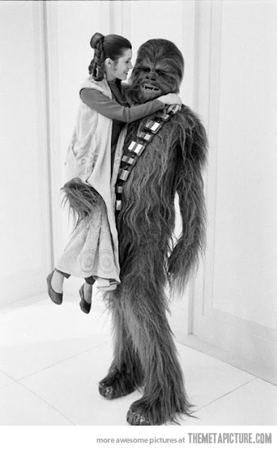 Chewy holding Princess Leia Chewbacca - Friday Frivolity Star Wars edition, via Devastate Boredom - funny memes and video clips!