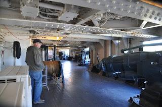 man standing on battleship gun deck