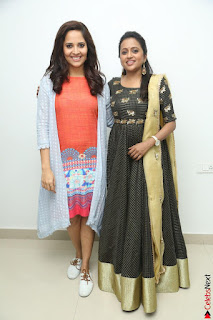 Actress Suma in Black Salwar Suit and Anusuya in orange Dress at winner movie press meet part 1 February 2017 (4).JPG