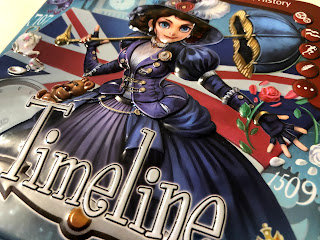 The embossed tin for the Timeline card game.