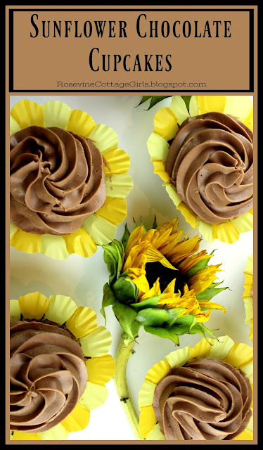 White background with chocolate cupcakes with chocolate whipped icing on top with a decorative sunflower. | RosevineCottageGirls.com#Spring #Recipe #Chocolate