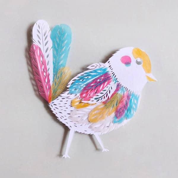 witte papercut vogel met pastel perkament accenten