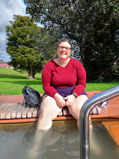 Heather soaking her feet and calves in an open-air foot pool