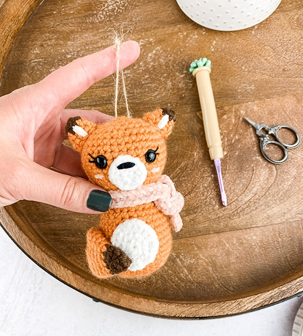 hand holding crochet fox ornament - Christmas in July