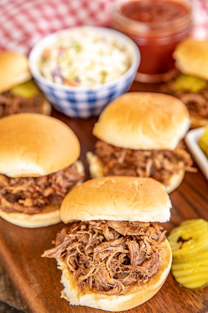 shredded beef sandwiches on serving board