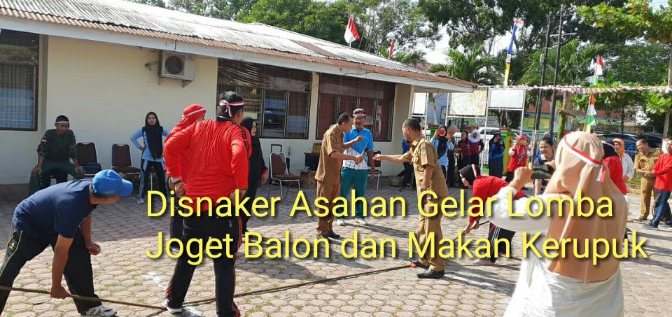 Pegawai Disnaker Asahan lomba tarik tambang, makan kerupuk dan joget balon.
