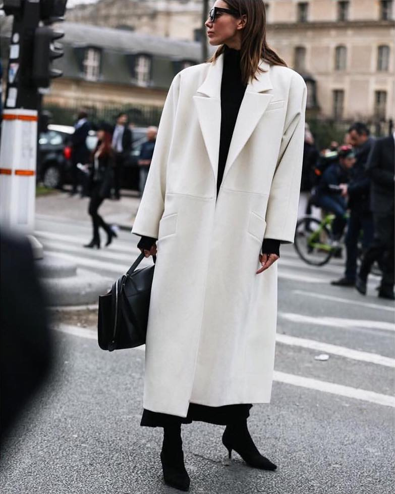 20 Best White Coats — Winter outfit idea from Julia Pelipas in a long white coat, turtleneck, and black boots