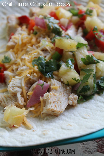 Chili Lime Chicken Tacos // Incredible chili lime chicken taco with grilled pineapple salsa -- they cannot be beat! #recipe #maindish #chicken #pineapple #tacos