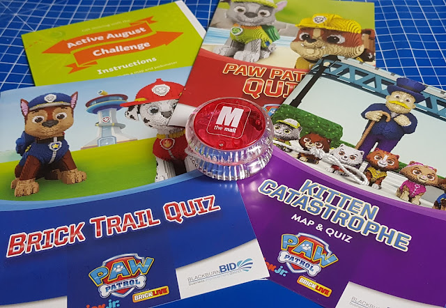 Brickburn Blackburn Paw Patrol LEGO trail maps and quiz leaflets laid out on a table