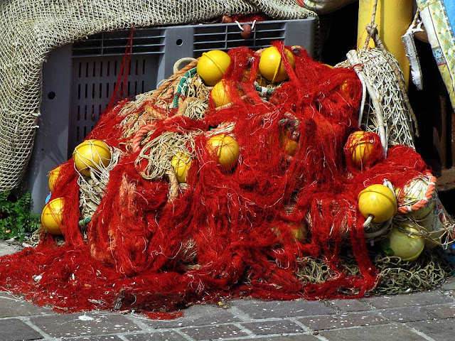 Red fishing nets and yellow buoys, Livorno