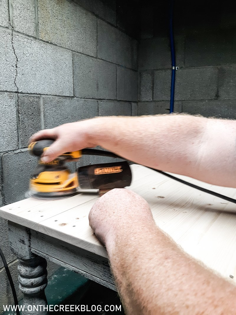 Sanding a farmhouse end table top | On The Creek Blog