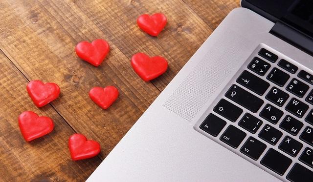 hearts beside macbook on wooden table