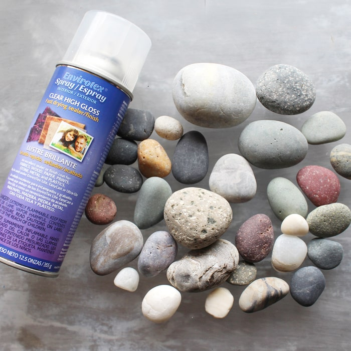 Envirotex clear high gloss resin spray with smooth dry rocks