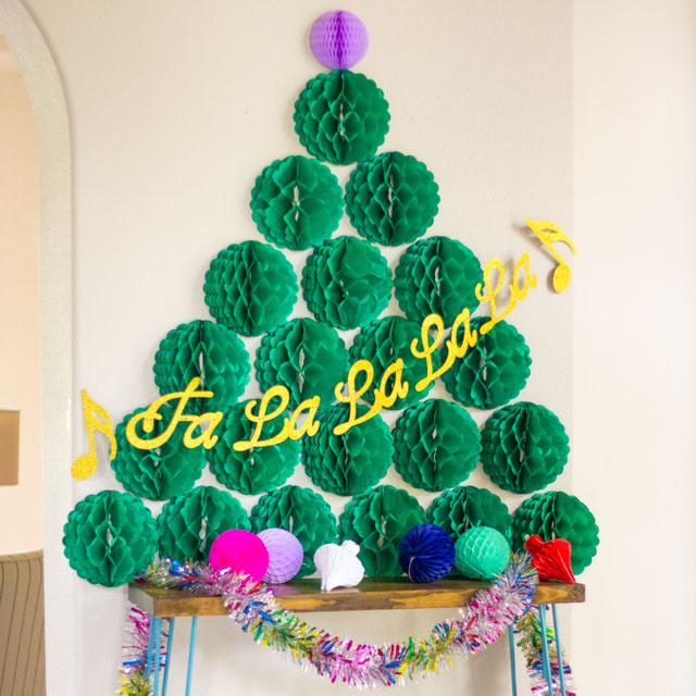 Such a fun decoration for a Christmas party - a honeycomb ball Christmas tree!