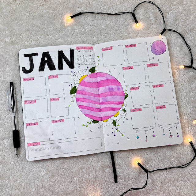 January bullet journal weekly spread with a planet and flowers