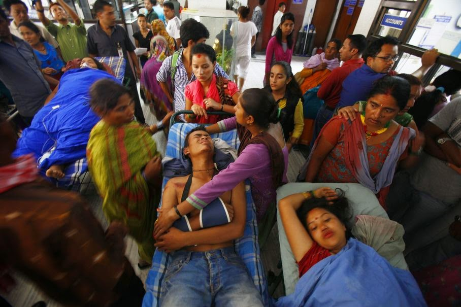 Landslide victims wait for treatment at a hospital in Katmandu, Nepal, Saturday, Aug. 2, 2014. A massive landslide killed at least eight people and blocked a mountain river in northern Nepal on Saturday, causing the water to form a lake that was threatening to burst and sweep several villages, officials said.