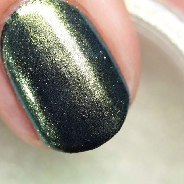 Girly Bits SFX Duo-Chrome Powder Resolution over black polish