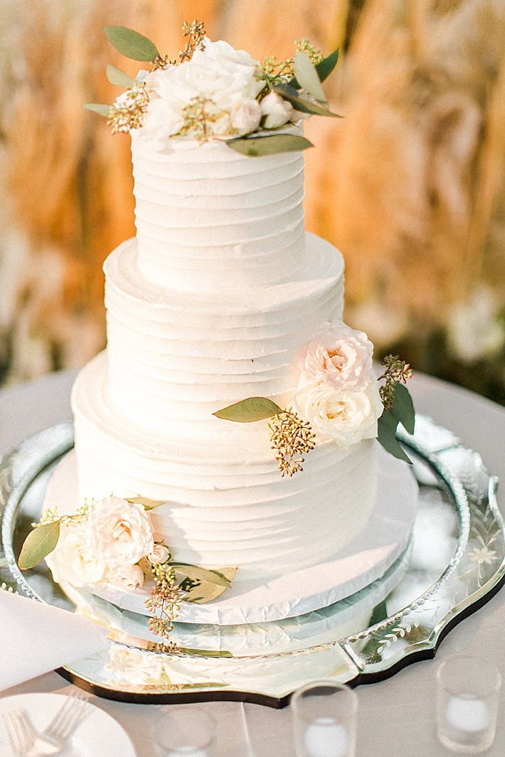White Buttercream Wedding Cake with Garden Roses | Photo by Matoli Keely Photography