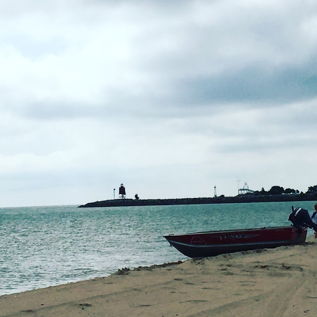 Lighthouse and boat on North Beach in Racine, Wisconsin.