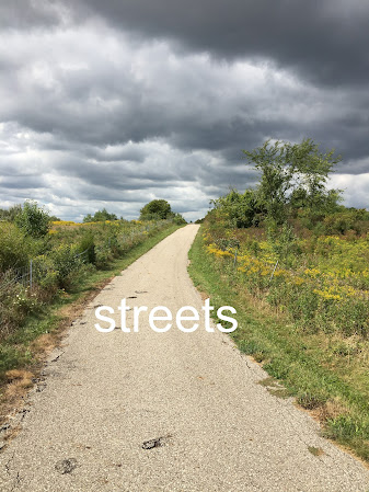 "Photo of a paved trail and the caption ""street"""