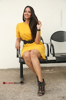 Actress Poojitha Stills in Yellow Short Dress at Darshakudu Movie Teaser Launch .COM 0220.JPG