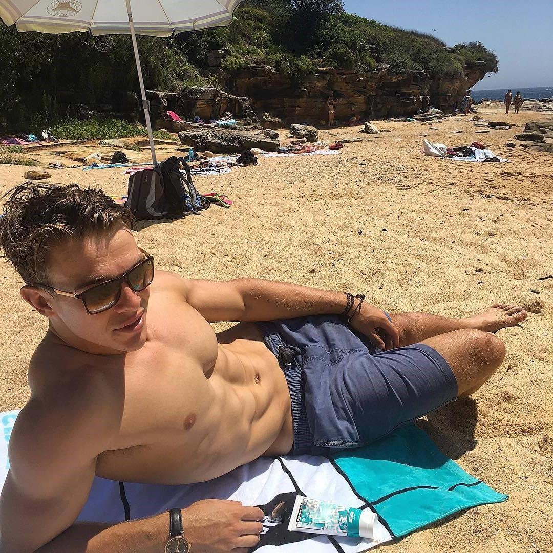 seductive-shirtless-muscle-hunk-charlie-taylor-beach-sunglasses
