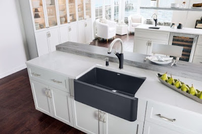 black kitchen sink with drainboard
