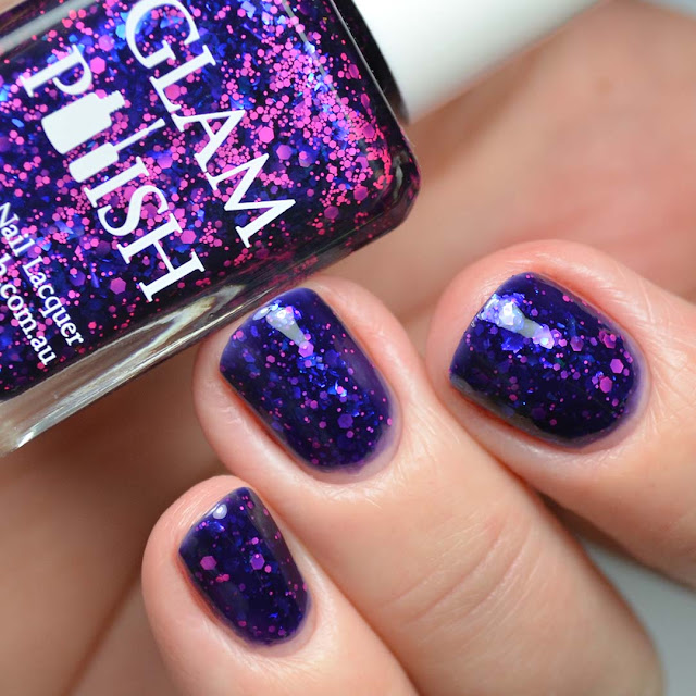 blue nail polish with pink glitter swatch