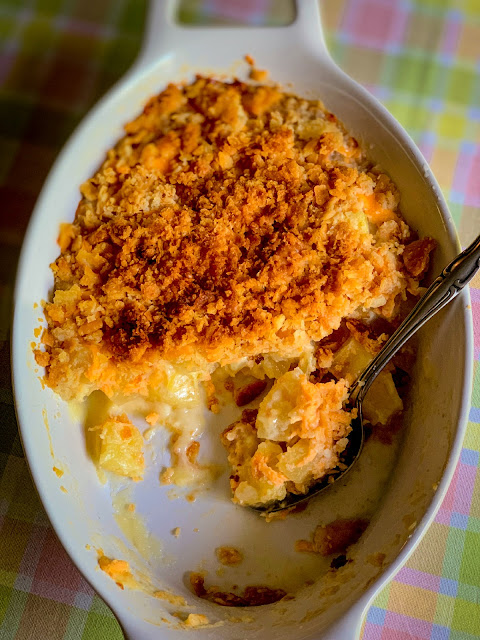 Pineapple Casserole, a sweet Southern casserole that can be served as a side dish or dessert at Easter on many Southern tables without a doubt.   It is made with canned pineapple, cheddar cheese, and topped with crumbled Ritz crackers.