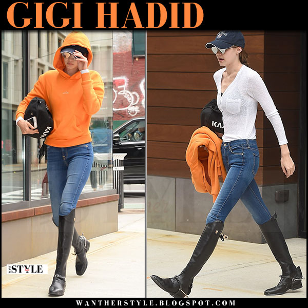 Gigi Hadid in orange hoodie holzweiler and black boots what she wore may 30 2017