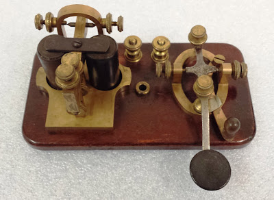 Rectangular wooden base with metal pieces attached used to send telegraph signals