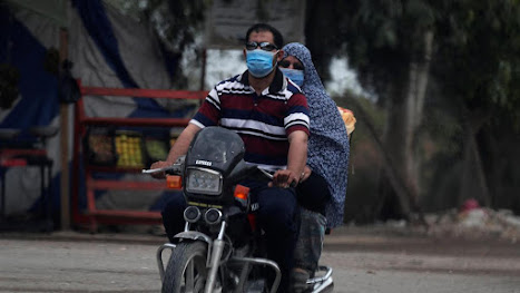 "Masks in Cairo ""Reuters"""