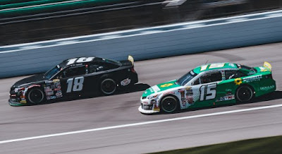 Ty Gibbs, driver of the No. 18 Joe Gibbs Racing Toyota, and Drew Dollar, driver of the No. 15 Sunbelt Rentals Toyota, in action during the Dutch Boy 150 for the ARCA Menards Series at Kansas Speedway in Kansas City, Kansas, on May 1, 2021.