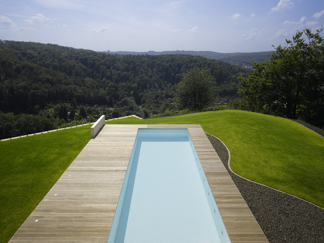 Photo of pool area in the backyard with the view