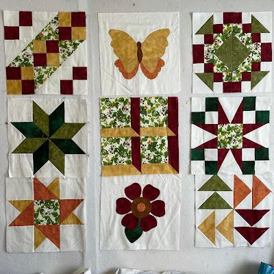 Nine finished quilt blocks on design wall