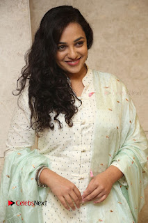 Actress Nithya Menen Latest Pictures in White Dress at 100 Days of Love Movie Audio Launch  0009.JPG