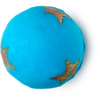 A close up of a large blue spherical bath bomb with golden stars all over it on a bright background