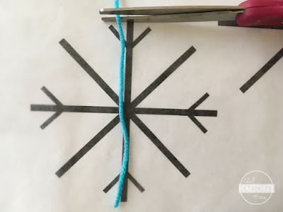 yarn snowflake craft for kids