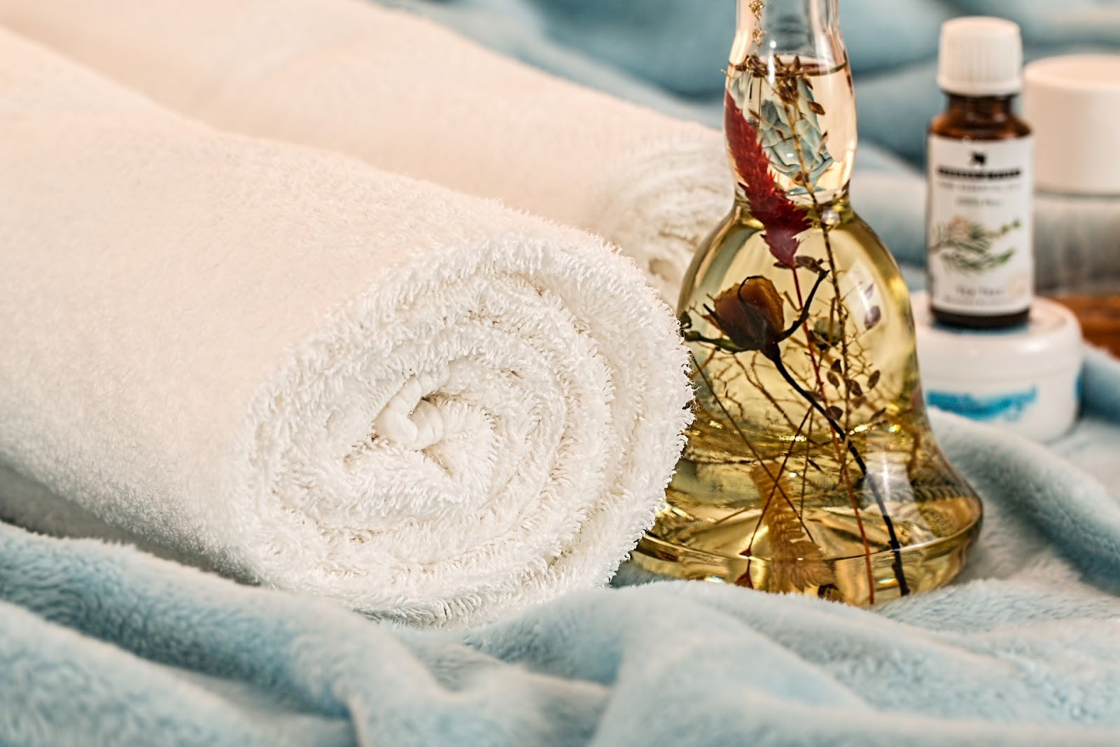 Rolled spa towels with massage oil