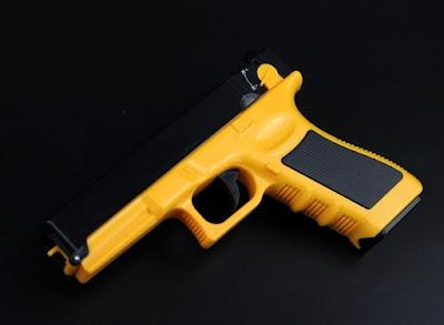 Súng bắn thun Glock màu vàng