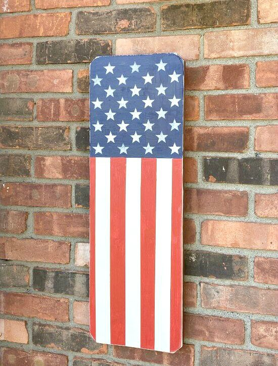 Wooden American flag on a brick wall