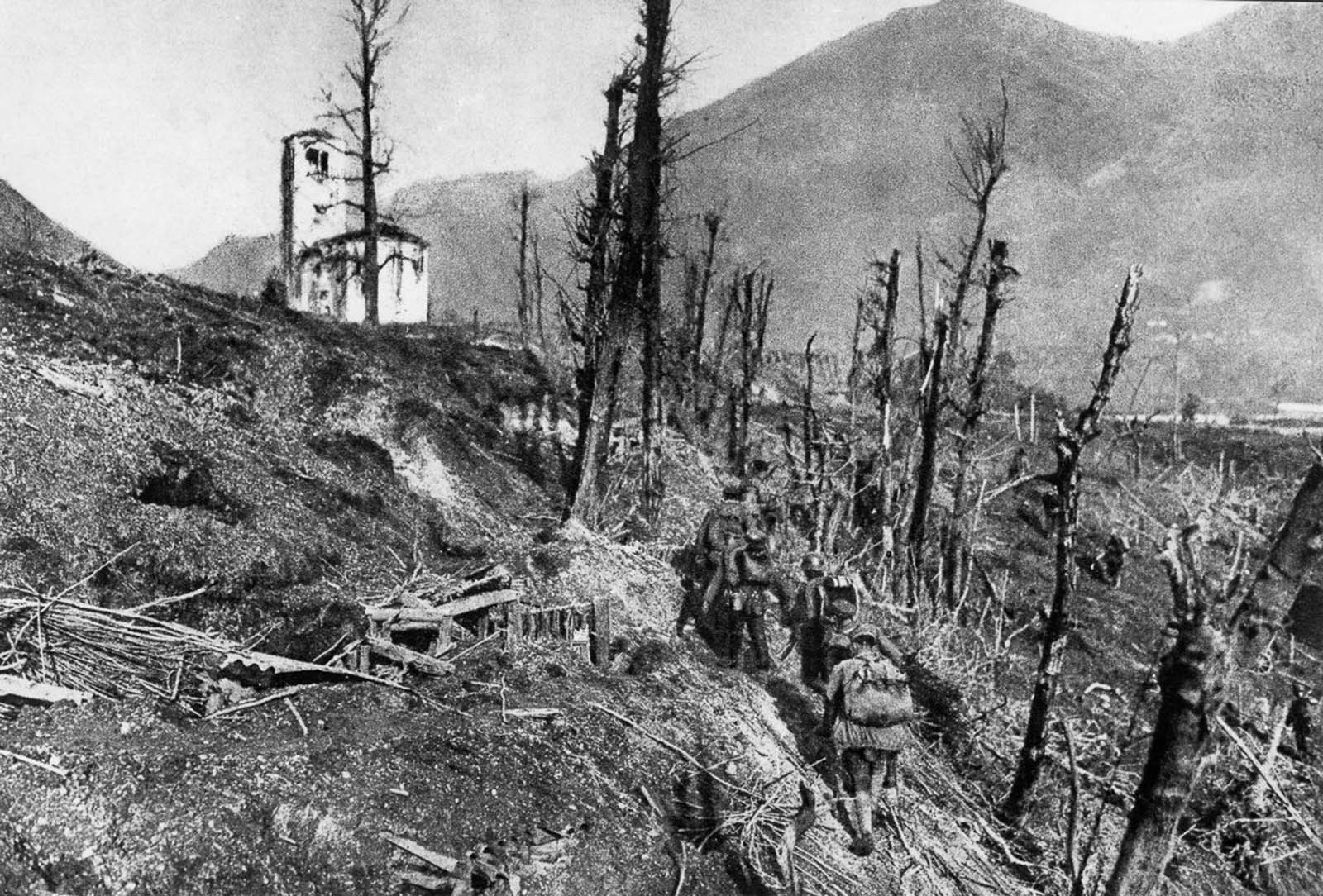 German soldiers pass through destroyed Italian positions near St. Daniel during the 12th Battle of the Isonzo. 1917.