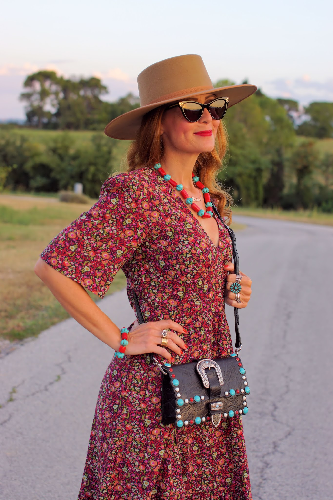 A transitional western style outfit with a ba&sh Paris dress and Lack of Color hat e
