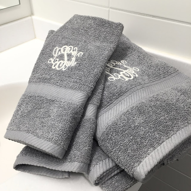 gray towel with white monogram