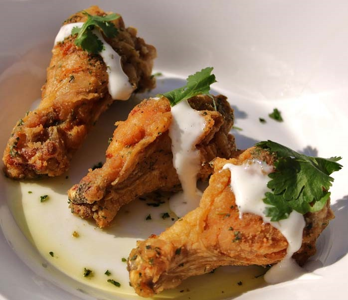 these are fried chicken wings with blue cheese dressing over them