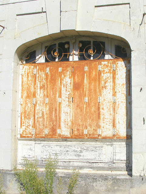 Old metal window shutters. Indre et Loire. France. Photo by Loire Valley Time Travel.