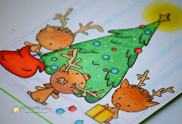 Reindeer decorating Christmas Tree card